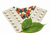 Pills And Capsules Medical Bio With Green Leaf