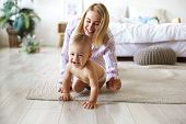 Cute Cheerful European Infant In Diaper Having Joyful Facial Expression, Laughing While Crawling On  poster