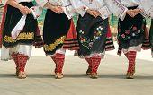 Girls Dancing Folk Dance. People In Traditional Costumes Dance Bulgarian Folk Dances. Close-up Of Fe poster