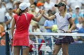 FLUSHING - AUGUST 30: Justine Henin-Hardenne of Belgium (L) shakes hands with Zuzana Ondraskova of the Czech Republic after defeating her at Arthur Ashe Stadium on August 30, 2005 in Flushing, NY.