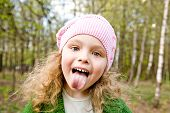 Cheerful Girl Puts Out The Tongue