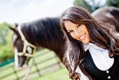 Beautiful woman portrait smiling with a horse