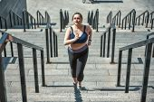 Doing All My Best. Active Plus Size Woman In Sports Clothing Running Up The Stairs While Exercising  poster