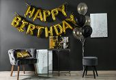 Room Interior With Gift Boxes And Phrase Happy Birthday Made Of Golden Balloon Letters poster