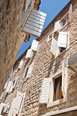 stock photo of louvers  - Typical mediterranean street with wite louvers on windows - JPG