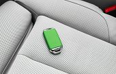 Closeup Inside Vehicle Of Wireless Green Leather Key Ignition On White Leather Seat. Wireless Start poster