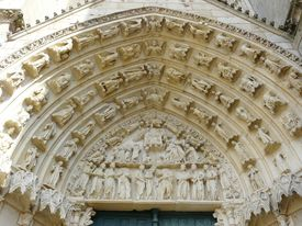 stock photo of poitiers  - Figures on the exterior of a church in Poitiers - JPG