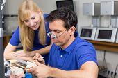 Apprentice Watching Dental Technician