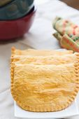 stock photo of jamaican  - Three Jamaican beef patties on a plate - JPG