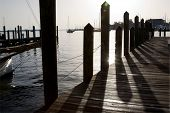 Shadows cast from the pilings onto the wooden planks of the city dock in the downtown area of Annapo
