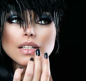 Fashion Art Portrait Of Beautiful Girl. Vogue Style Woman. Hairstyle. Black Hair and Nails. Isolated