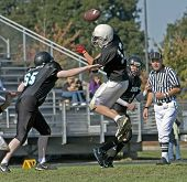 Youth Football Blocking A Pass