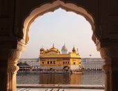 Amritsar Golden Temple - India. Framed with windows from west side. focus on temple
