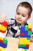 Child Builds A Tower
