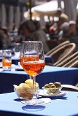 Aperol Glasses At An Outdoor Cafe