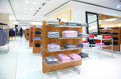 Clothing On Shelfs In A Empty Modern  Store