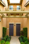image of entryway  - A condo in Southern California has doors that open to a courtyard type entryway - JPG