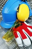 hardhat, gloves, earmuffs and glasses, protective clothing concept
