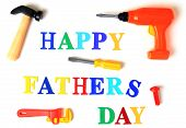 Happy fathers day spelled out in toy letters and tools.