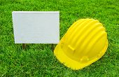White Wood Sign And Safety Helmet
