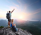 picture of breathtaking  - Hikers relaxing on top of a mountain and enjoying sunrise - JPG