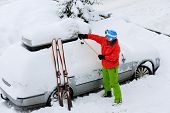 Ski, Winter, snow, car - skier man is shoveling the car of snow
