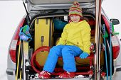 Winter, skiing, journey - girl with ski equipment ready for travel to ski resort