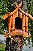 picture of hollow log  - a fairy hollow house made over entrance to willow tree hollow in a park - JPG