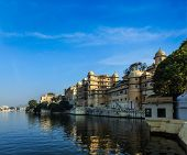 Romantic India luxury tourism concept background - Udaipur City Palace and Lake Pichola. Udaipur, Ra