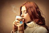 beautiful woman drinking hot tea