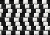 Optical illusion: parallel lines made from black and white pillows