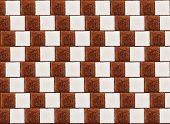 Optical illusion: parallel lines made from lumps (cubes) of white and cane sugar