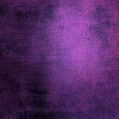 Abstract purple background or paper with bright center spotlight and dark border frame with grunge b