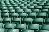stock photo of bleachers  - Rows of green seating in a large sports stadium - JPG