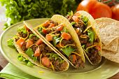 stock photo of ground-beef  - Homemade Ground Beef Tacos with Lettuce Tomato and Cheese