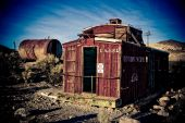 stock photo of caboose  - An old caboose that has been converted to a home in the ghost town of Rhyolite Nevada - JPG