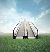 stock photo of escalator  - Concept of easy opportunity to success with escalator in a field - JPG