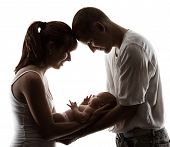 Family With Newborn Baby. Parents Silhouette Over White