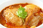 stock photo of curry chicken  - Close up Muslim style chicken and potato curry or chicken mussaman curry - JPG