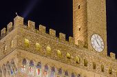 Detail of the Old Palace at night (Palazzo Vecchio or Palazzo della Signoria), in Florence (Italy).