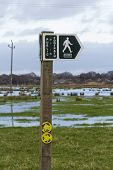 Footpath Sign With Floods