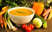pic of vegetable soup  - Vegetable soup surrounded by fresh vegetables - JPG