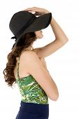Sideview Of A Female Model In A Sunhat And Swimsuit