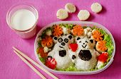 stock photo of lunch box  - Bento in the form of bears in a box on a pink background - JPG