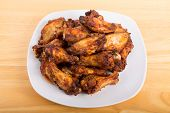 Mesquite Chicken Wings On White Plate And Wood Table