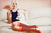 Closeup Portrait Of Cute Blonde Girl With Candy And Rabbit Toy