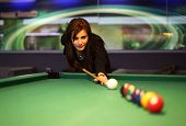 foto of snooker  - Young brunette girl playing snooker - JPG