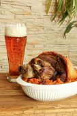 Baked Pork Shank With Sauerkraut And Beer