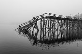A Broken Down Wooden Bridge