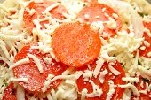 Extreme Close-up Of Raw Pepperoni Pizza